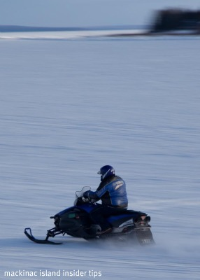 The Ice Bridge allows snowmobilers to head to the Island for a day of fun!