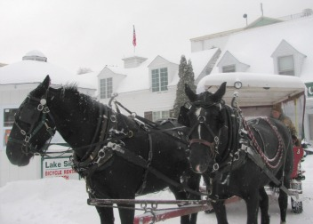 A horse drawn taxi meeting you for your Mackinac Island, Michigan cross country skiing vacation.