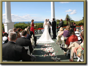 A Grand Hotel wedding is spectacular on their Front Porch overlooking the Straits of Mackinac.