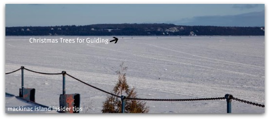 Christmas trees guide people when using the Ice Bridge to Mackinac from St. Ignace.